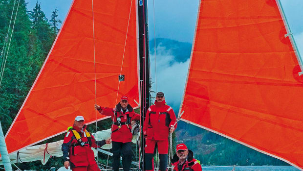 Safety first! The crew tries the storm sails on for size before setting off