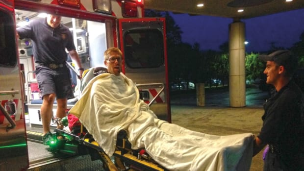 The author gets tucked in before his ambulance ride from the dock to a hospital in Newport