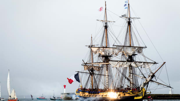 L'Hermione's cannon sound off as she enters the harbor.