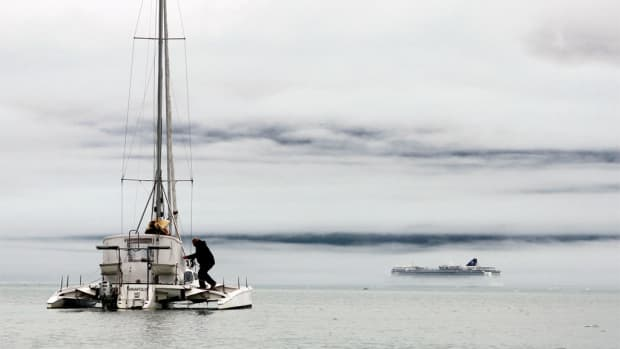 Out of the mist in Glacier Bay, a cruise ship emerges to break the magic spell of the crew's solitary reverie