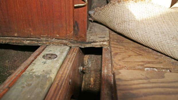 Here you can see the water-damaged floor under the compression post