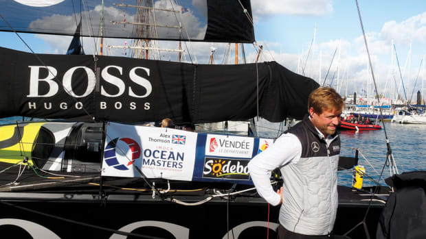 Alex Thomson on the dock in Les Sables d'Olonne, wearing earbuds to drown out the roar of the madding crowd, the day before the start of the Vendée Globe this past November