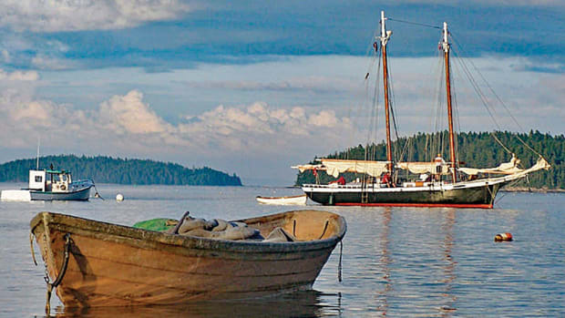 Work boats and classic boats sit side by side in the mooring field in Stonington, Maine. Photo by Philip Mace