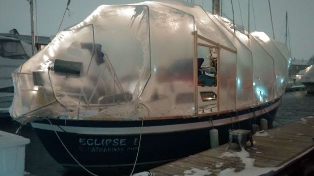The boat in its winter cocoon on a dark night