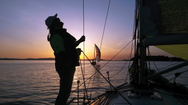 Trimming the chute as the sun goes down on a quiet evening off Vallejo, California, near San Francisco Bay. Photo by SAIL reader Victor Beltran.