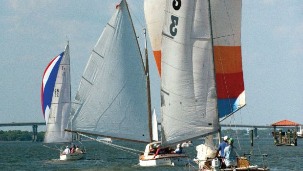 "Three classic boats head toward the finish line at Beaufort Yacht & Sailing Club—from left, Sam ""Woody"" Norwood's Myrdie III, Roy Crocker's True Love and Buddy Sharpton's Three Part Harmony"