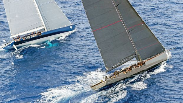 The 100ft WallyCentos Magic Carpet³ (left) and Open Season battle to windward at the 2015 Maxi Yacht Rolex Cup. Photo courtesy of Rolex SA