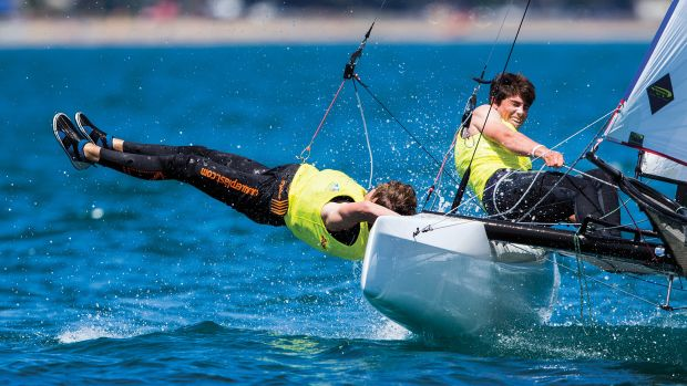 Trying out a new trapezing style at the Sailing World Championships in Auckland, New Zealand