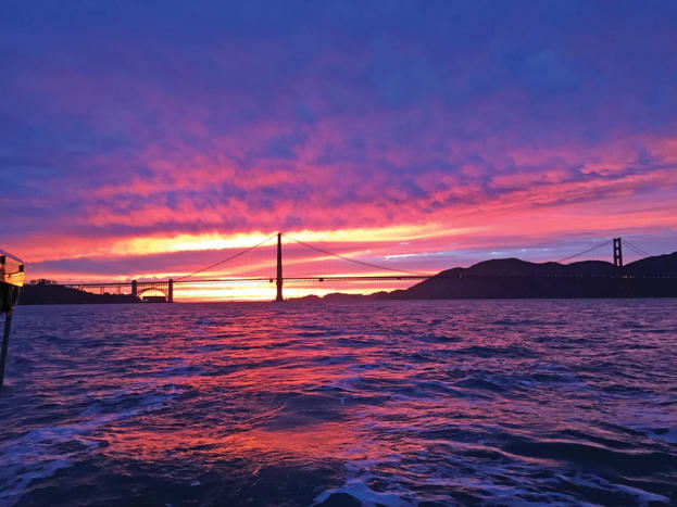 Coming into San Francisco Bay, looking back to the Golden Gate Bridge at sunset. Photo by Joseph Lyvers