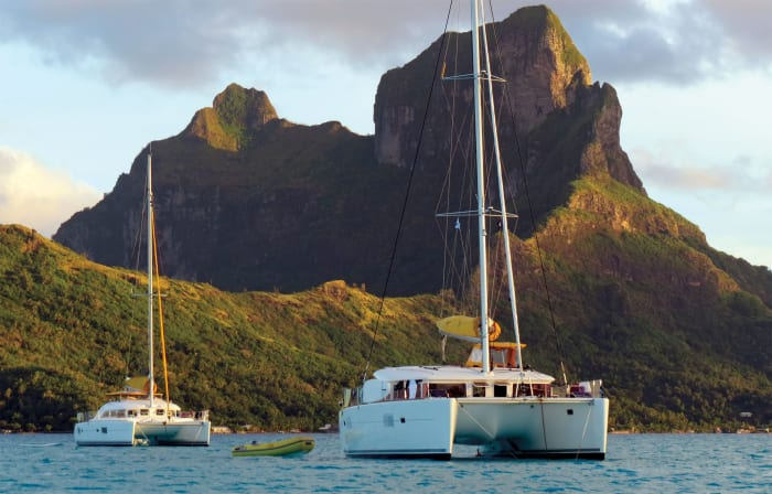 Anchoring out, as opposed to paying for a mooring, is a quick and easy way to save money when chartering