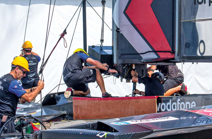 The shore teams were critical to success in AC35: here a new wing is fitted to the Kiwi boat