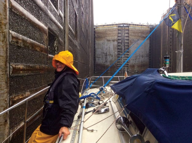 Captain Sue Kelly negotiating lines for a lock passage in inclimate weather