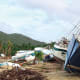 The boats washed up along the shore of Trellis Bay were a sad sight