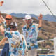 Merlin's creator, Bill Lee, (right) takes the helm at the finish of the 2017 Transpac