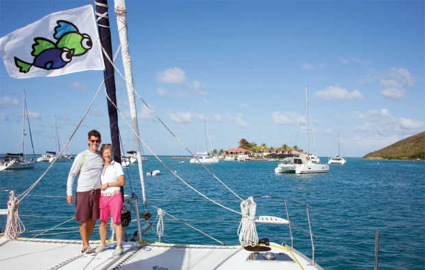 Jason and Gail after arriving in the BVI, with their flag flying proudly