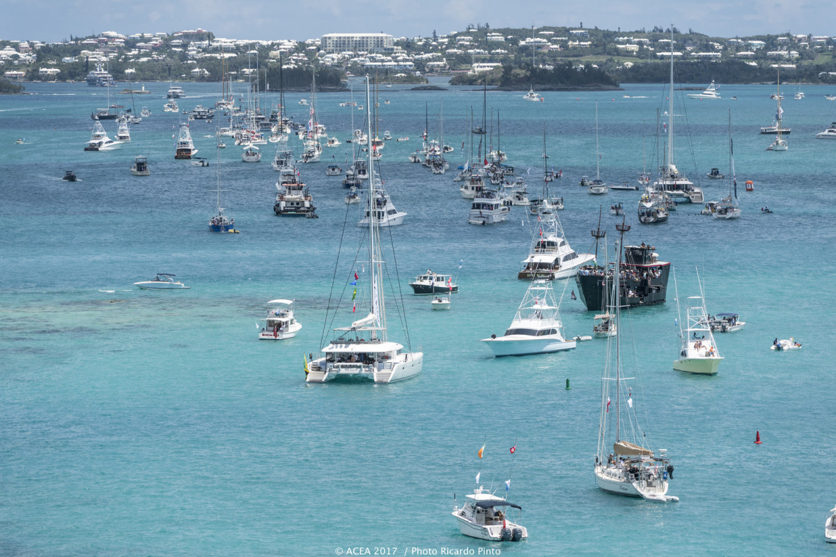 The spectator fleet watches the fun from out on the turquoise waters of Bermuda's Great Sound