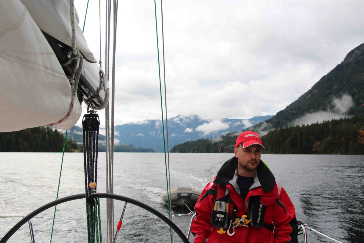 Jon eases ClaraALLEGRO  through Sechelt Inlet, where boreal forests crawl out of the icy water