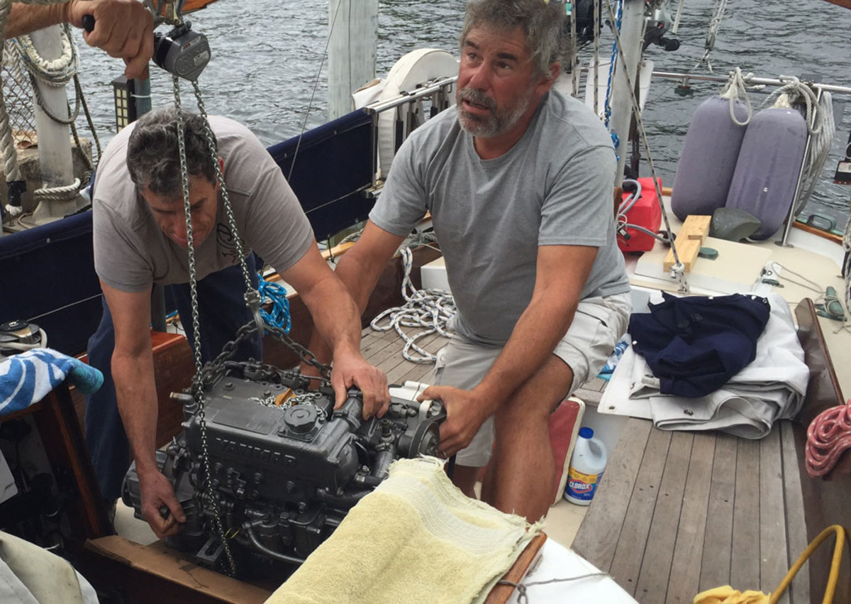The author helps remove the flooded engine from his Pearson Invicta