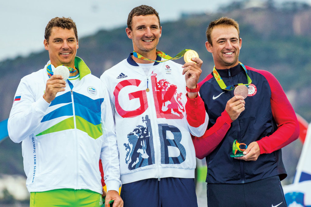 Finn-class medal winners (from left) Vasilij Zbogar of Slovenia, Giles Scott and Caleb Paine with their silver, gold and bronze medals