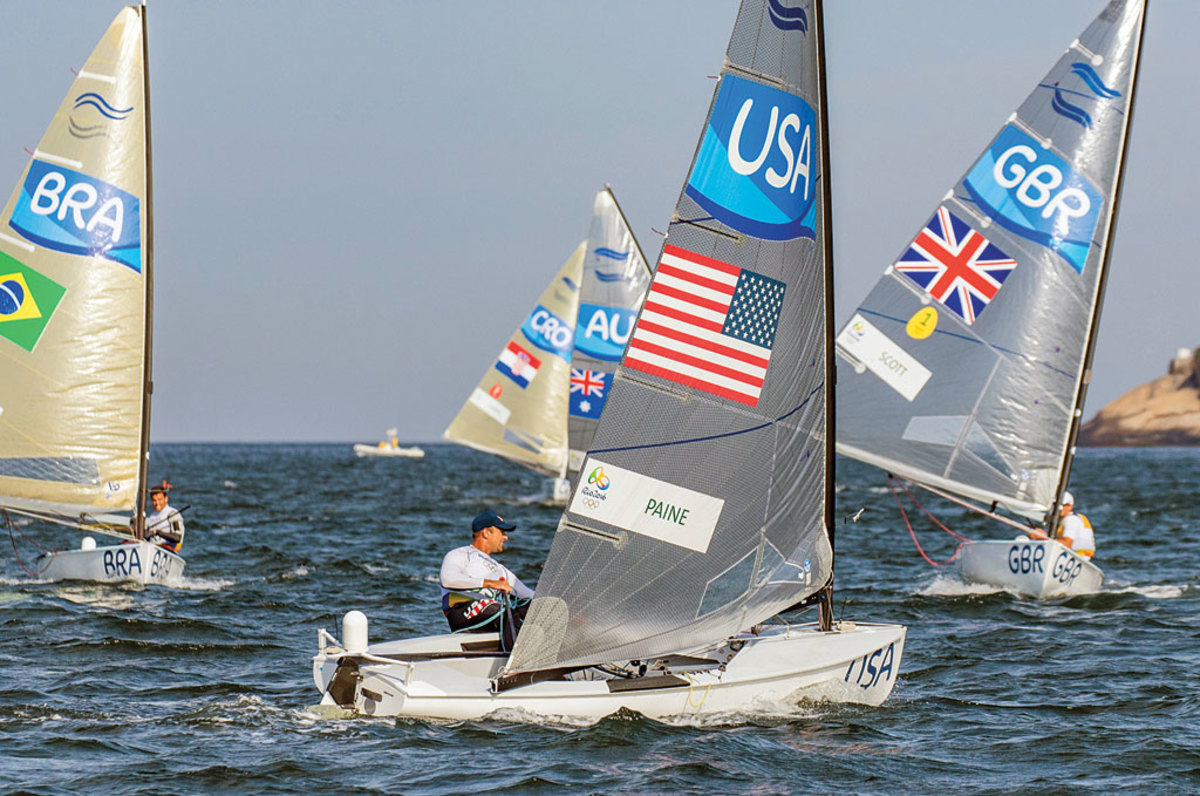 Paine heads upwind under the watchful eyes of gold-medal winner Giles Scott of Great Britain