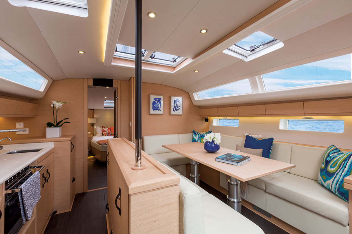 The in-line galley to port has been carefully configured to harmonize with the saloon