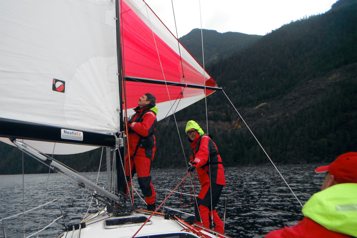 Pushing for maximum boatspeed, Steve and Geir fly the kite on a reach down Salmon Inlet