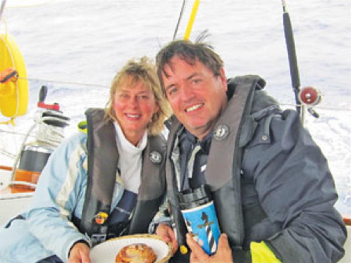 Linda and Hugh Moore aboard Wild Goose in mid-ocean. Photo by Linda & Hugh Moore