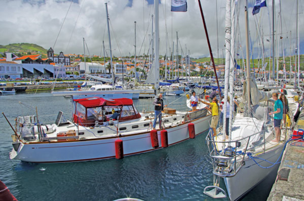 The Bristol 45.5 Sage is greeted by fellow World ARC sailors on arriving in Horta. Photo by Mia Karlsson