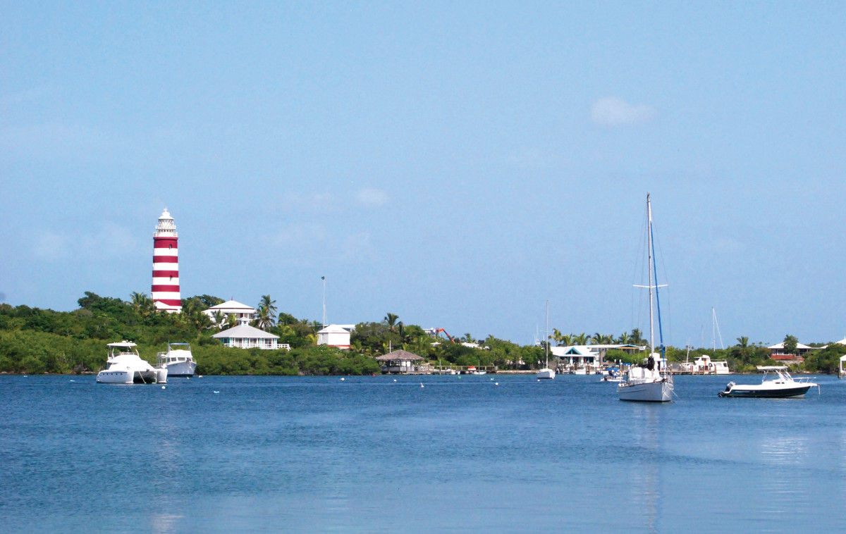 An uncrowded shoulder-season view of the Hope Town lighthouse on Elbow Cay. Photo by Adam Cort