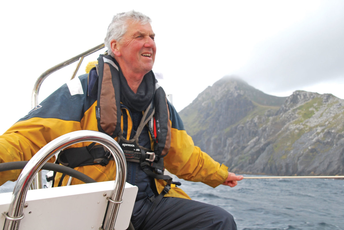 The author at the helm of Wild Song with Cape Horn a mere stone's throw away. Photo courtesy of Mike Godfrey