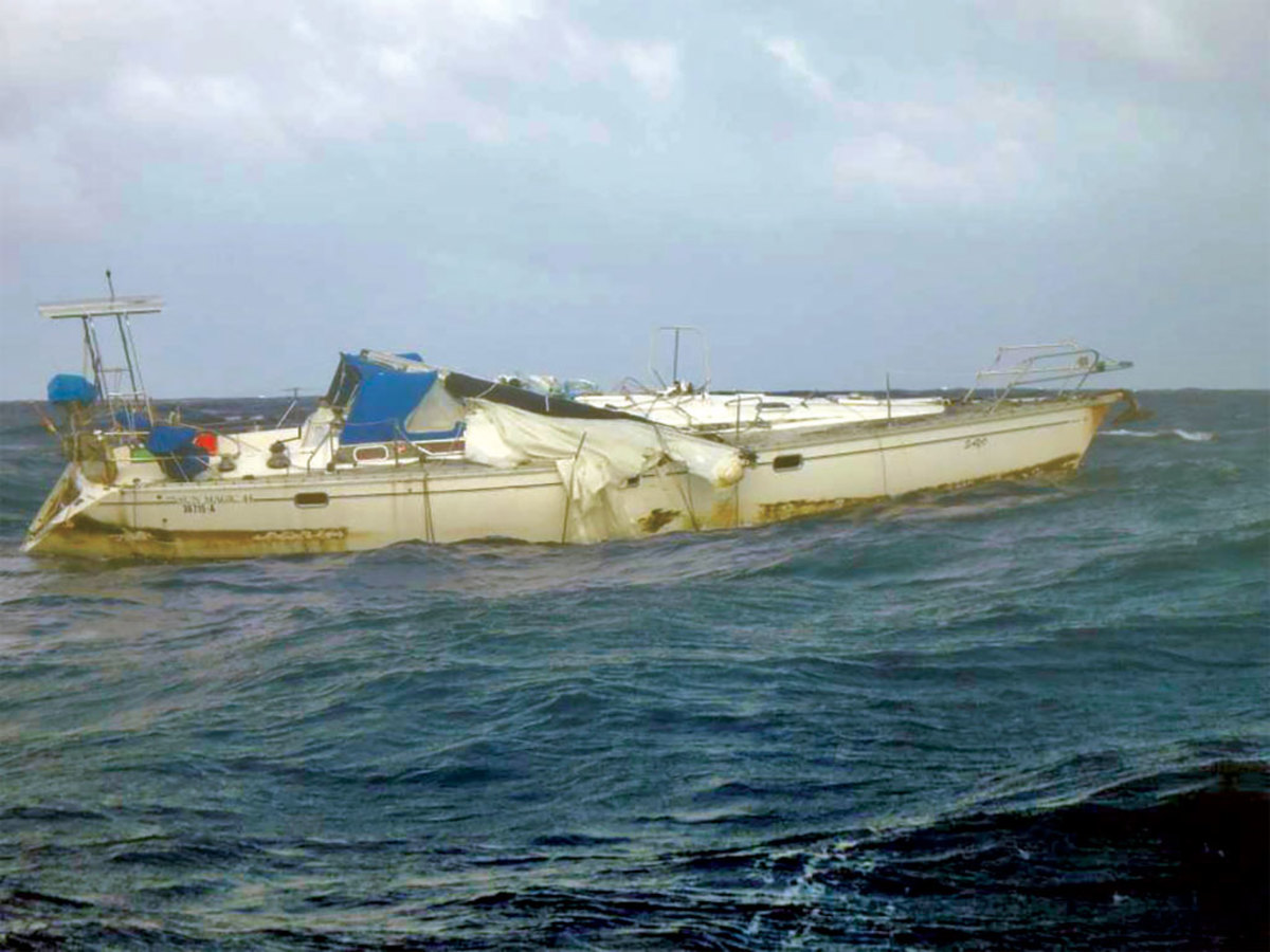 A racing crew found this dismasted boat off the Philippines, with her skipper's body aboard