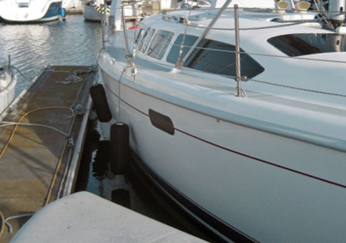 Turning the wheel to port moves the starboard quarter into the dock, and that makes it easy to step off the boat