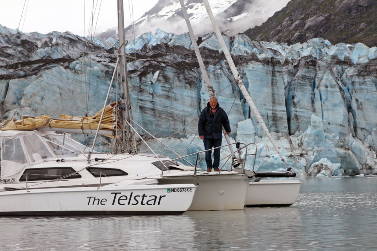 Tony and the Telstar pictured against the icy backdrop of Lamplugh Glacier in Glacier Bay