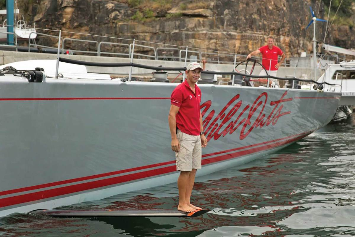 A crewman stands on one of the athwartships foils on the maxi Wild Oats XI. a crewman stands on one of the athwartships foils on the maxi Wild Oats XI. Photo courtesy of Andrea Francolini/Cruising Club of Australia