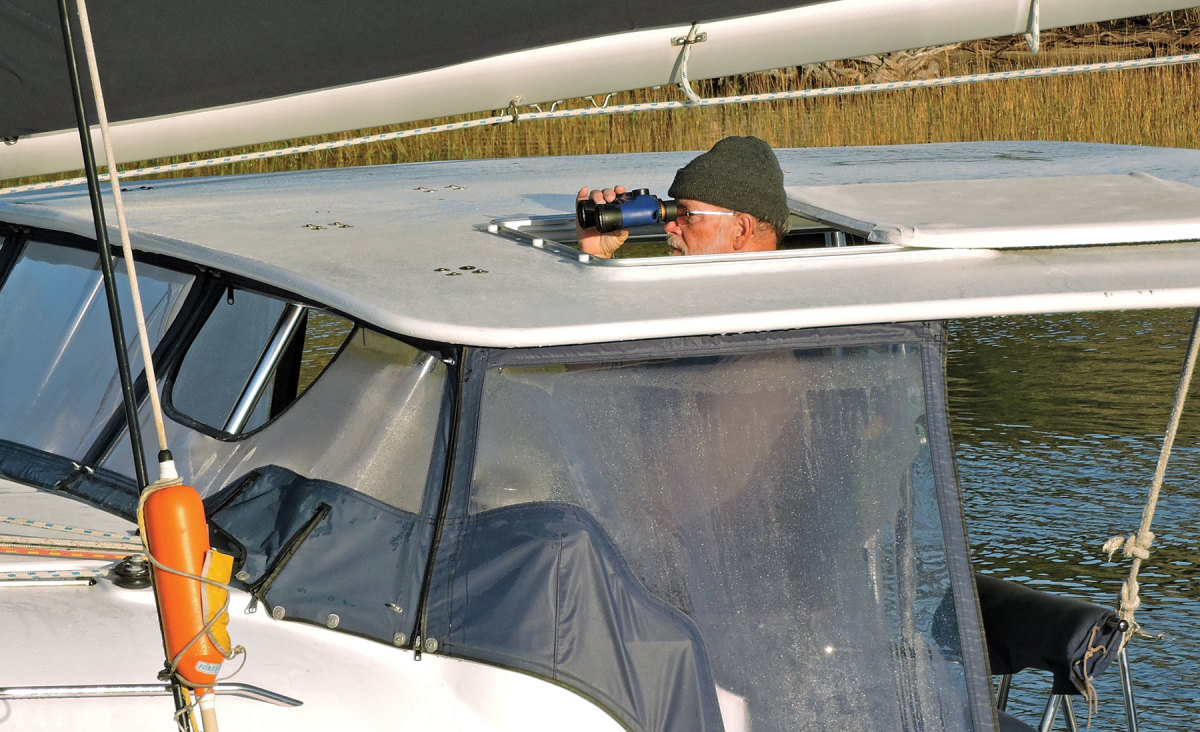 """Now where's that bridge..."" Steve Spracher keeps a solitary lookout aboard his Lagoon 38"