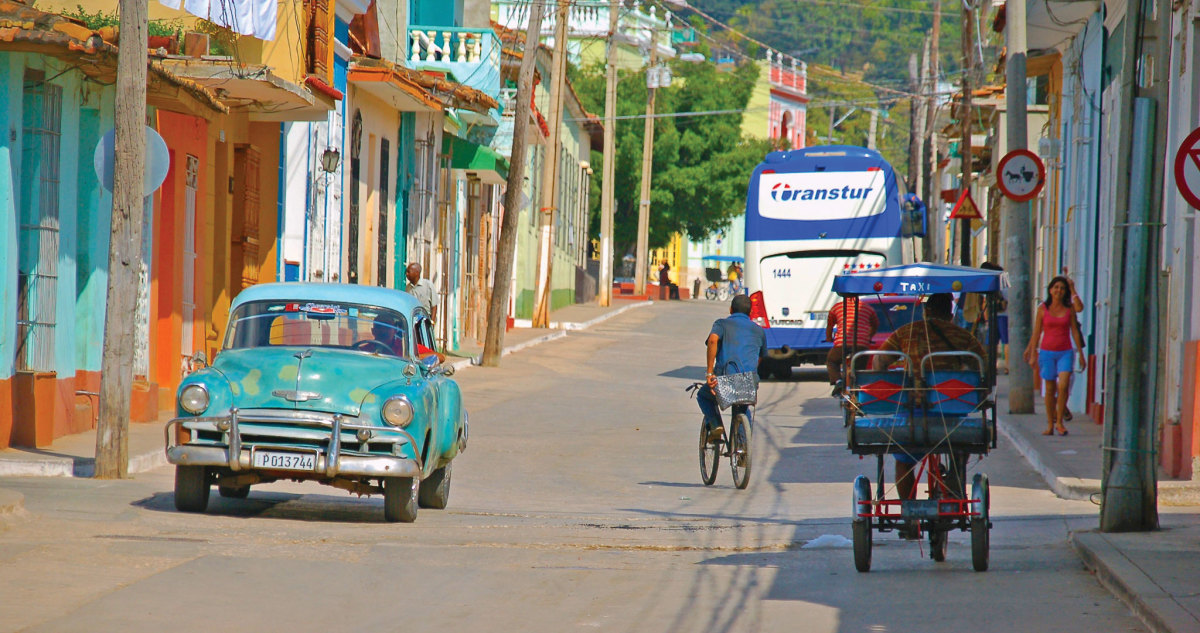 A classic car sits roadside in Cuba. Photo by Ian Ridgeway