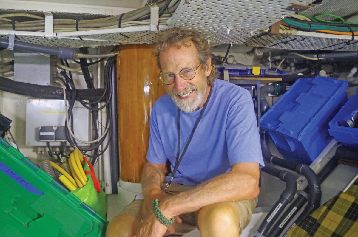 Nat Benjamin explores the engine room of the Herreshoff schooner Mariette at Port Antonio, Jamaica. Photo courtesy of Chris Museler