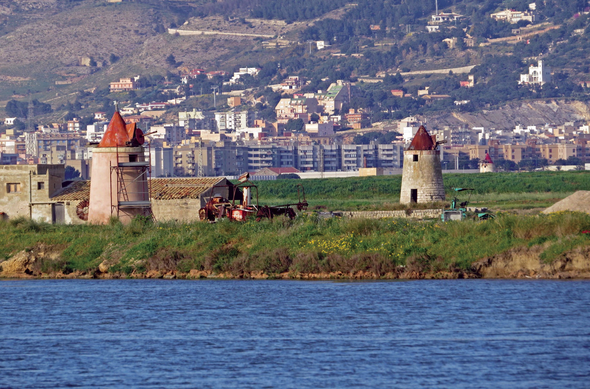 Old salt ponds and windmill pumps in Trapani, Sicily