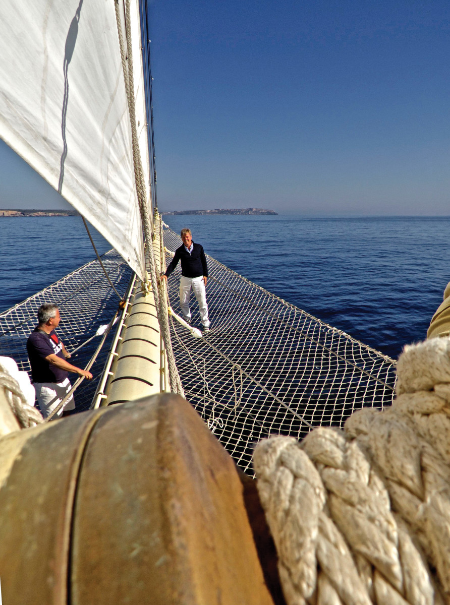 The Star Clipper's helmsman, a Malta harbor pilot and the captain fill the compact bridge