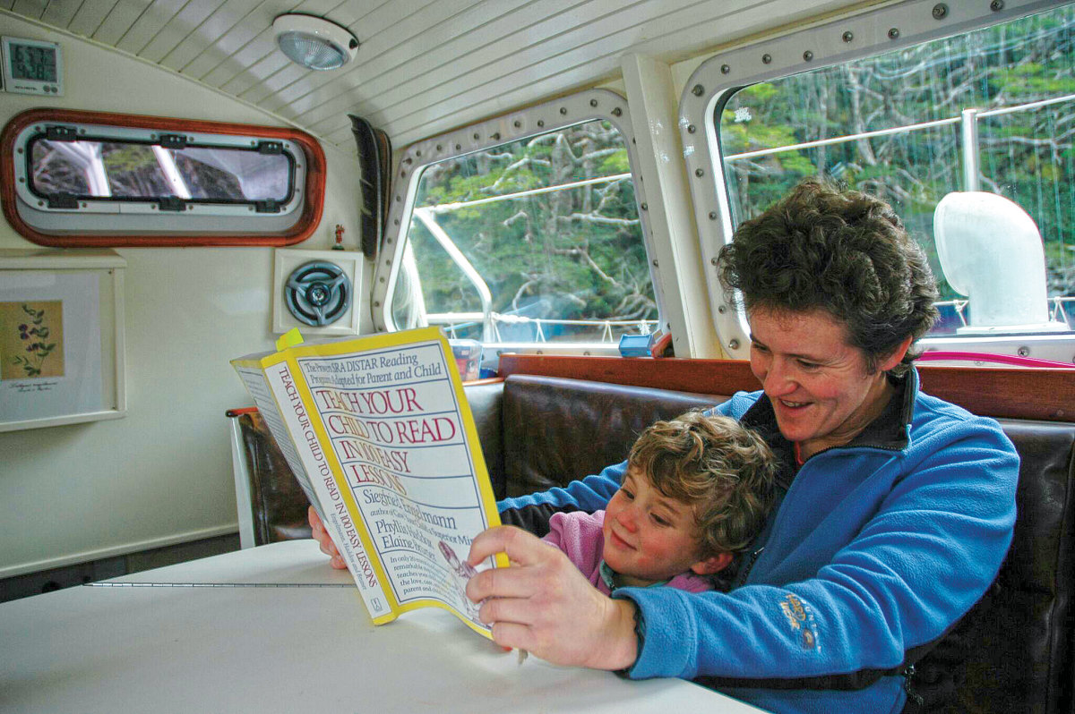 The author works with Anna on her reading skills in a Tierra del Fuego anchorage