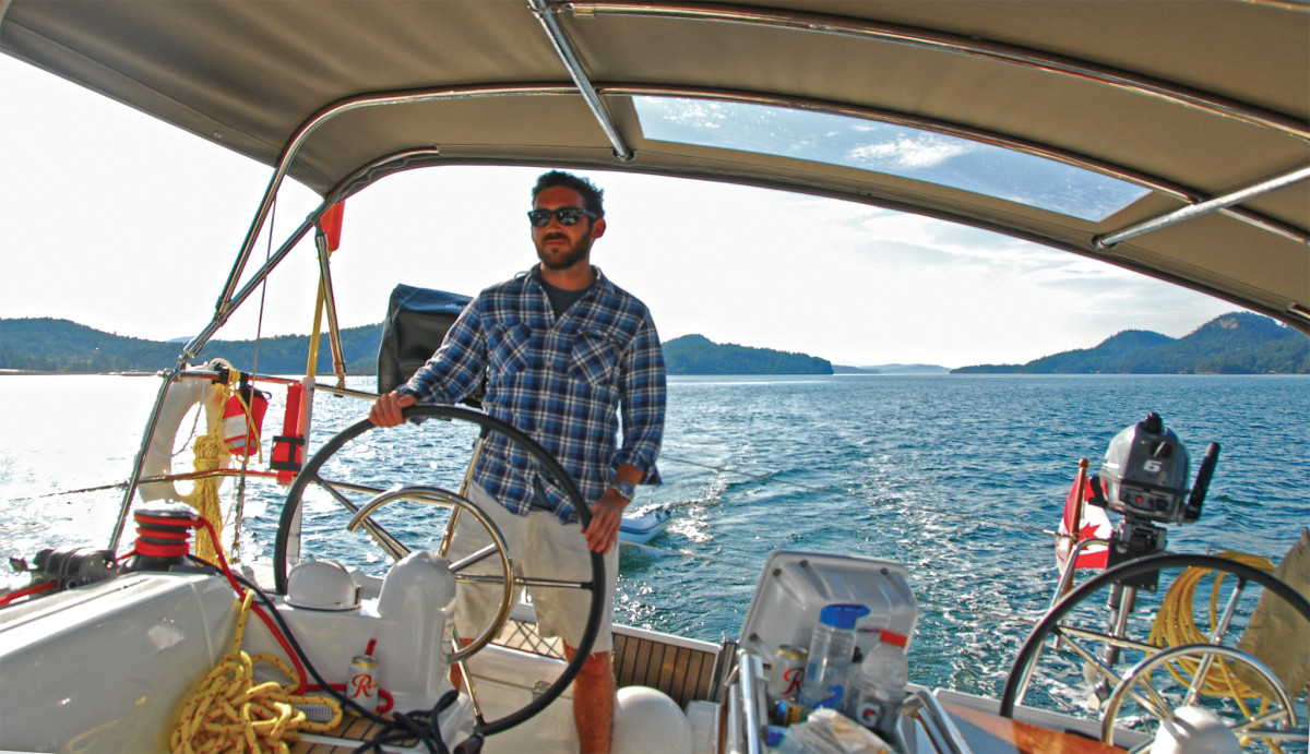The author at the helm on the way to Montague Harbour