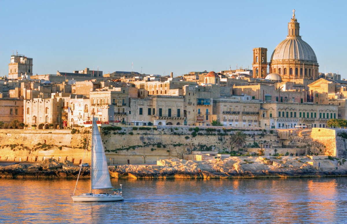 Malta's capital, Valletta, glows in the evening sun. Robwilson39/Dreamstime.com
