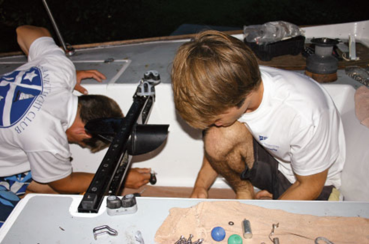 Cockpit gear after installation: note the new mainsheet traveler bar in place. David (right) is installing the traveler cleats while Mike (left) is installing the backstay blocks