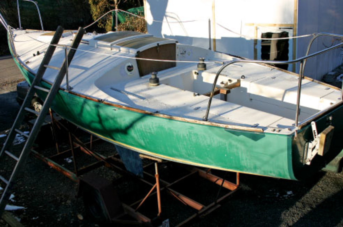 The original mainsheet traveler support can be seen together with the original winches. The winches were stripped and soaked in a kerosene bath to get all the grease off them before being re-oiled and reinstalled. They still work perfectly