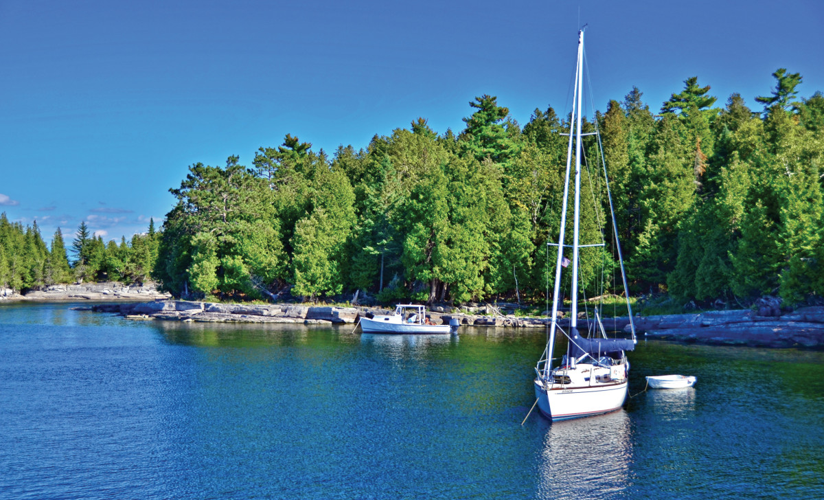 Two boats swing at anchor in Spoon Bay off Valcour Island