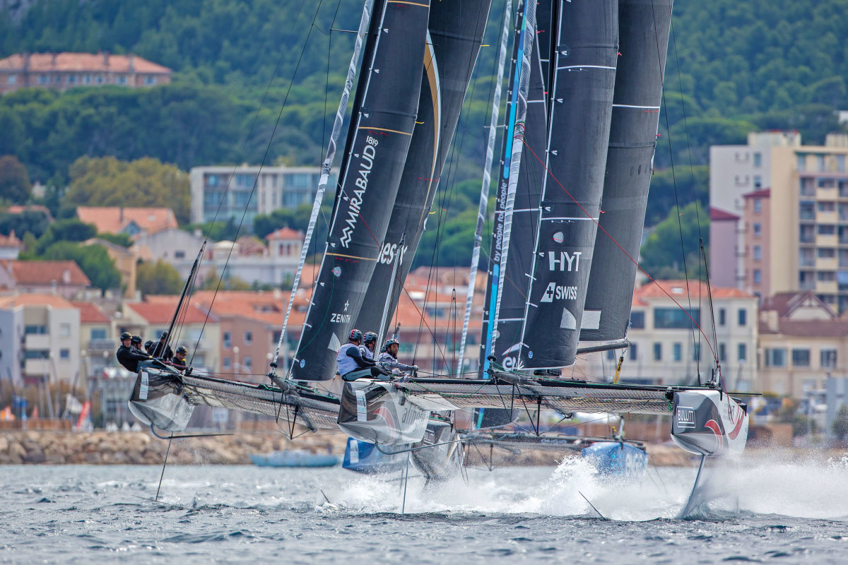 Sailboat racing doesn't get much more dramatic than three full-foiling catamarans locked in battle within spitting distance of shore! Photo courtesy of Lloyd Images/Extreme Sailing Series
