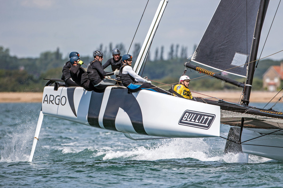 U.S. sailor Jason Carrol's Argo tears up the Solent during a GC32 racing tour stop in Cowes, England. Photo courtesy of Sander van der Borch/Bullitt GC32 Racing Tour