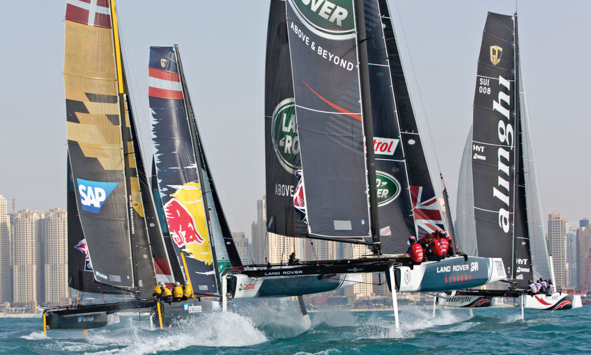 the Extreme Sailing Series fleet rips toward the Muscat shoreline in Oman midway through the first regatta of 2016. Photo courtesy of Lloyd Images/Extreme Sailing Series