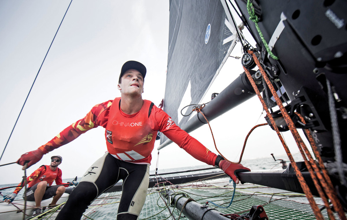U.S.V.I. skipper Taylor Canfield (in glasses) and crew Shane Diviney competing in Oman. Photo courtesy of Lloyd Images/Extreme Sailing Series