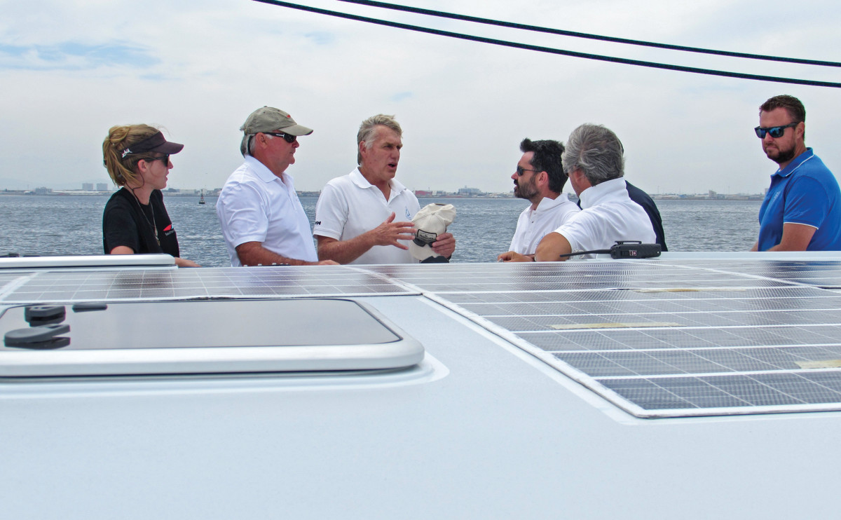 Jonathan Paarman (middle, hat in hand) with the Balance Yachts brain trust during a sail in Cape Town harbor